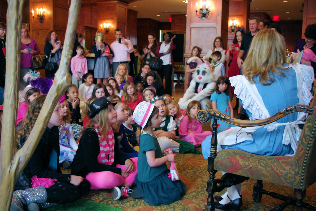 Alice reads Alice in Wonderland at O.Henry Hotels Mad Hatter Tea